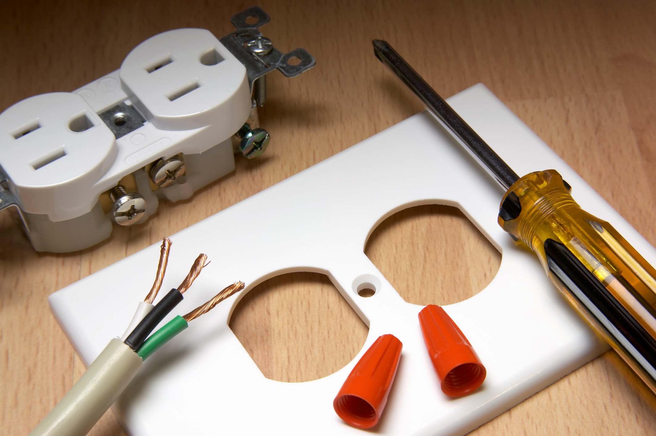 American electrical outlet and cover plate, with screwdriver and wire nuts